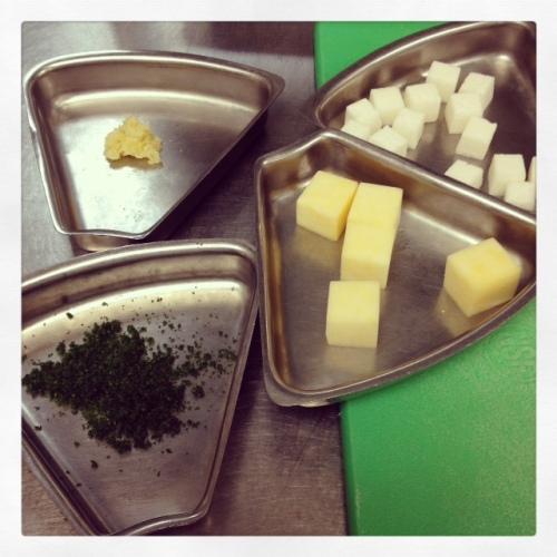 Garlic paste, minced parsley, medium and large dice.